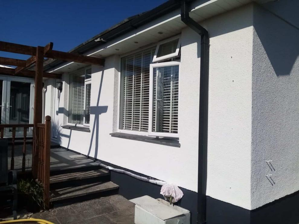 side of house with brand new never paint again wall coating in cornwall