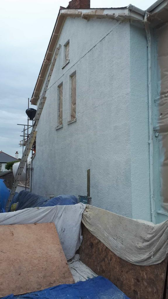 ide wall in exmouth being repaired-min