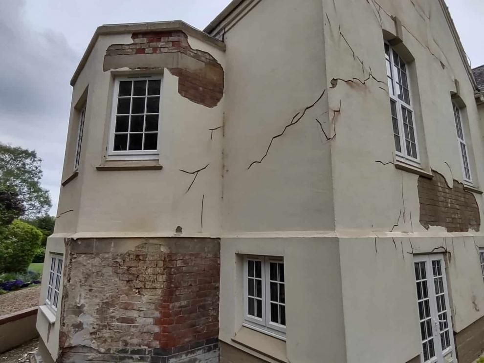 side wall needing render repairs