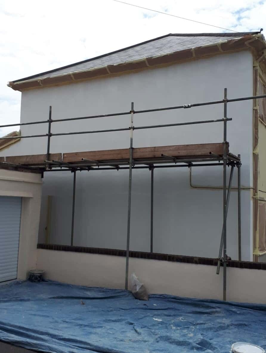 side wall of house with wall coating primer