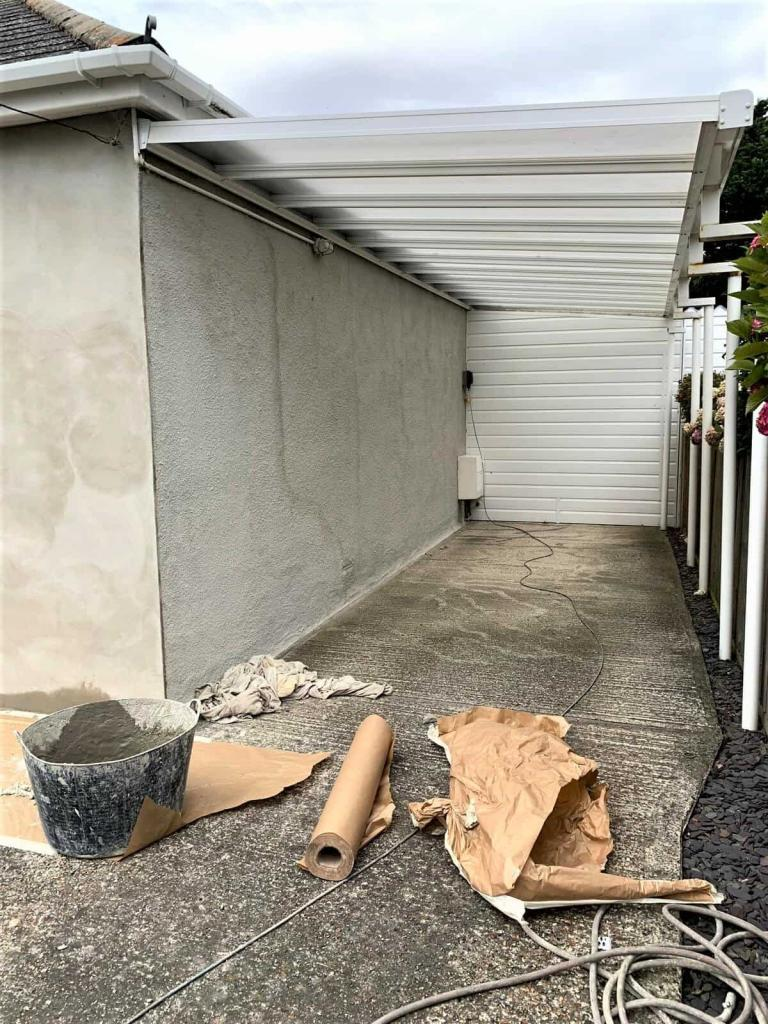 side wall under car port being repaired prior to painting