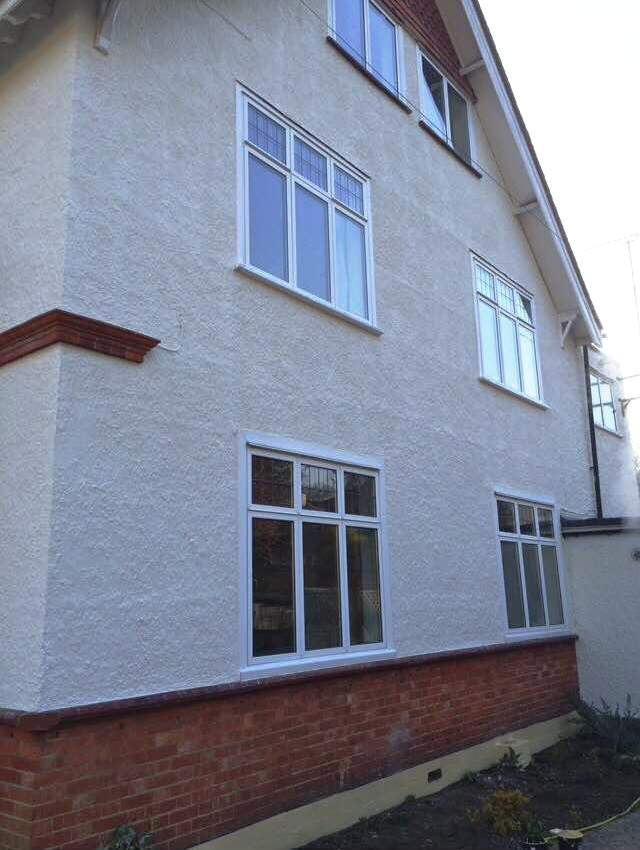 house in Farnborough with a durable Textured external wall covering